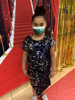 CVE second grader on red carpet
